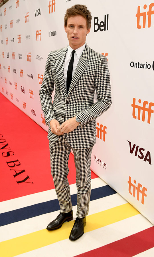 "<strong><a href=""/tags/0/eddie-redmayne"">Eddie Redmayne</a></strong> looked classy and chic in a houndstooth suit on the red carpet for <i>The Aeronauts</i> on Sept. 8.
