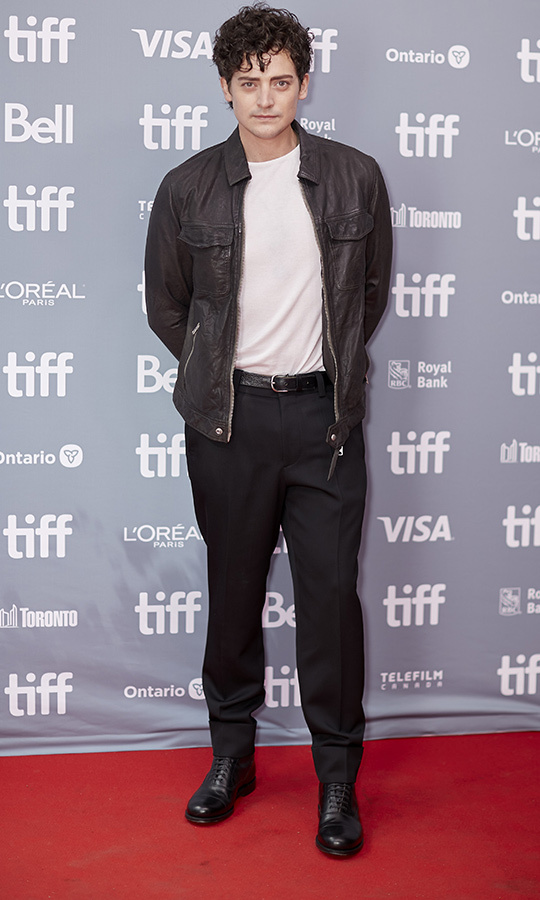 Welsh star <strong>Aneurin Barnard</strong> looked very rock 'n' roll at the press conference for <i>The Goldfinch</i> on Sept. 8 in a leather jacket, Doc Marten boots, black jeans and a white T-shirt.