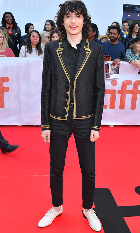 "<strong><a href=""/tags/0/finn-wolfhard"">Finn Wolfhard</a></strong> looked dapper in a very unique black suit with gold trim, which he paired with white shoes. 