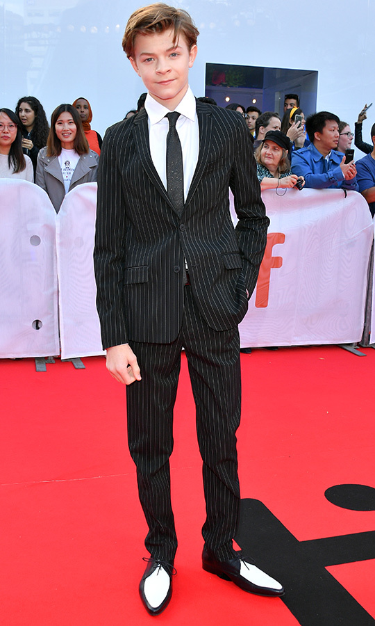 "Rising star alert! <strong><A href=""/tags/0/oakes-fegley"">Oakes Fegley</a></strong> showed off his dapper style with a pinstriped suit, black tie, white shirt and the best shoes we've seen yet at TIFF on the red carpet.