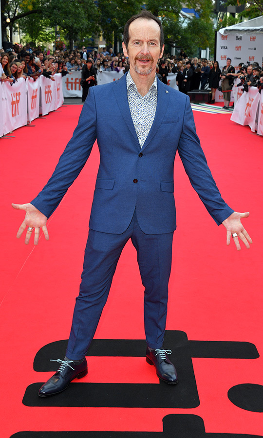 "<strong><A href=""/tags/0/denis-ohare"">Denis O'Hare</a></strong> showed off his big personality with a blue suit, polka dot dress shirt and black shoes with sky blue laces.