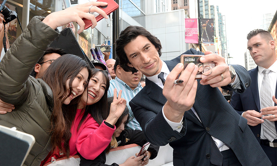 "<strong><a href=""/tags/0/adam-driver"">Adam Driver</a></strong> took selfies with fans outside the premiere of <i>Marriage Story</i> on Sept. 8.