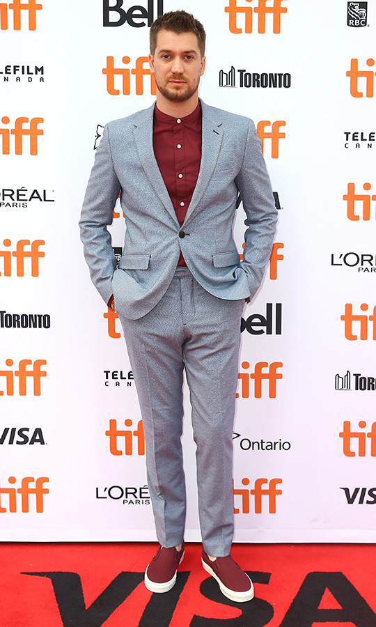 <strong>Rafael Casa</strong> pulled off a rarely seen look on red carpets - a grey suit with burgundy shirt and burgundy sneakers! He looked smoking at the <i>Bad Education</i> world premiere.