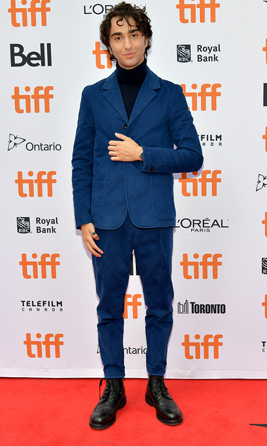 "<strong><a href=""/tags/0/alex-wolff"">Alex Wolff</a></strong> made several bold choices on the <i>Bad Education</i> red carpet, pairing a blue suit with a black turtleneck and Doc Martens.