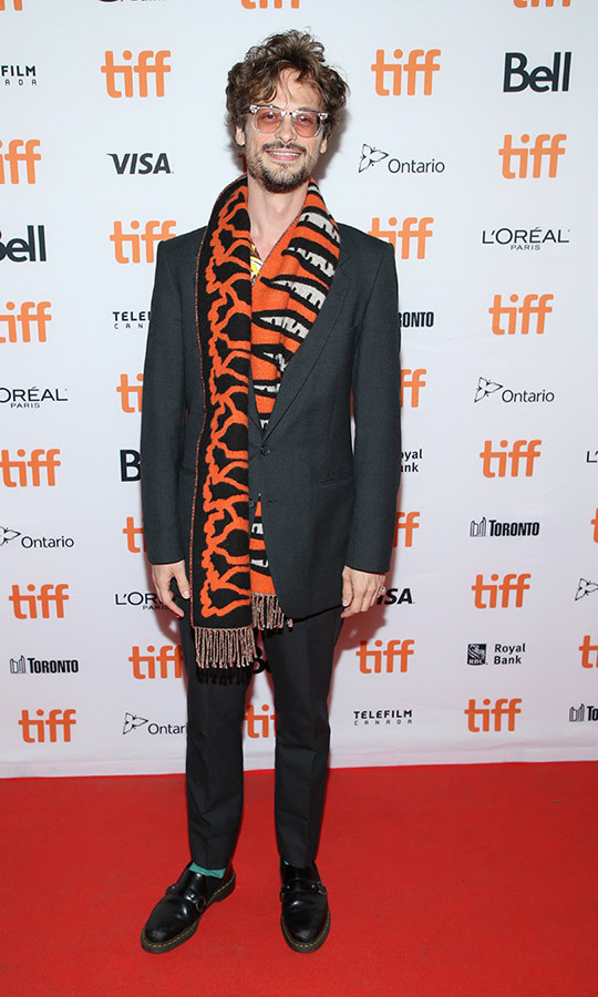 "<strong><a href=""/tags/0/matthew-gray-gubler"">Matthew Gray Gubler</a></strong> chose a unique tiger-esque scarf for his red carpet look at the <i>Endings, Beginnings</i> premiere.