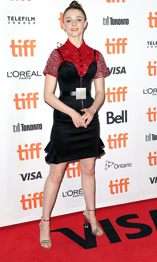 <strong>Thomasin McKenzie</strong> wore a red and gray sequined blouse on the <i>Jojo Rabbit</i> red carpet with a black dress and unique belt.