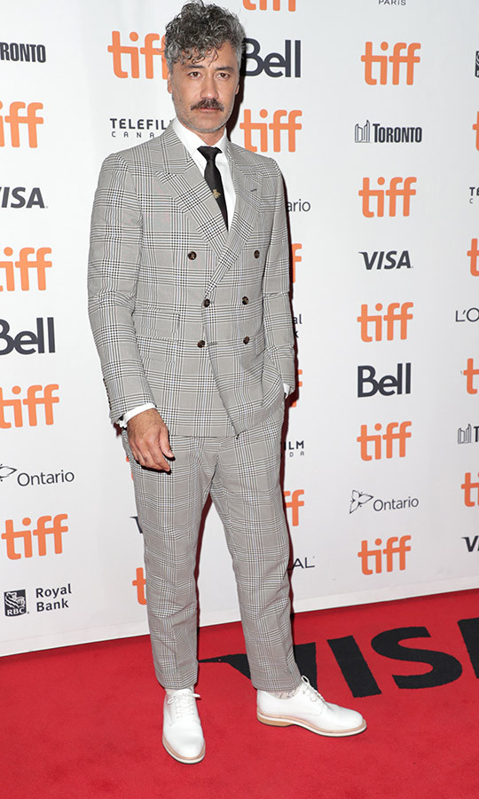 "Did <strong><a href=""/tags/0/taika-waititi"">Taika Waititi</a></strong>'s <i>Jojo Rabbit</i> premiere look make him the most dapper man at TIFF on Sept. 8? We think so!