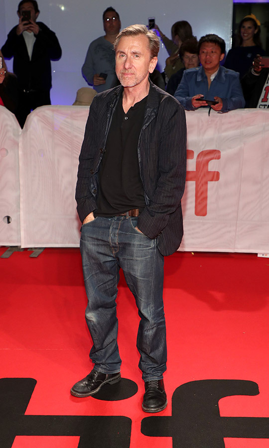 "<strong><a href=""/tags/0/tim-roth"">Tim Roth</a></strong> kept it casual on the red carpet for <i>The Song of Names</i>, sporting jeans, a black blazer and shirt and boots. 