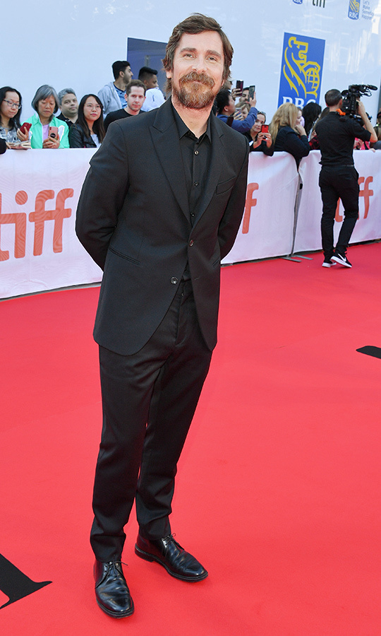 "A bearded <strong><a href=""/tags/0/christian-bale"">Christian Bale</a></strong> looked confident and dapper on the <i>Ford v Ferrari</i> red carpet on Sept. 9.