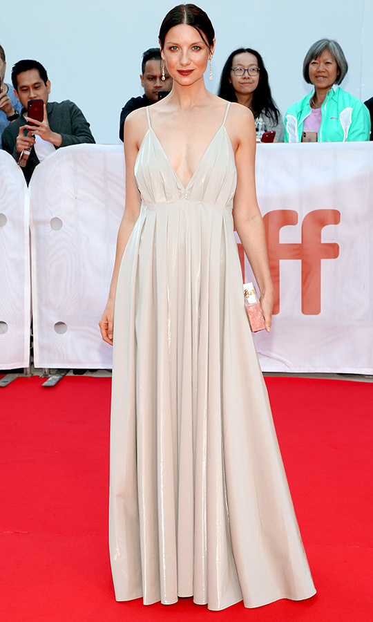"<strong><a href=""/tags/0/caitriona-balfe"">Caitriona Balfe</a></strong> looked like a total angel on the <i>Ford v Ferrari</i> red carpet in an off-white gown by New Zealand's Paris Georgia.