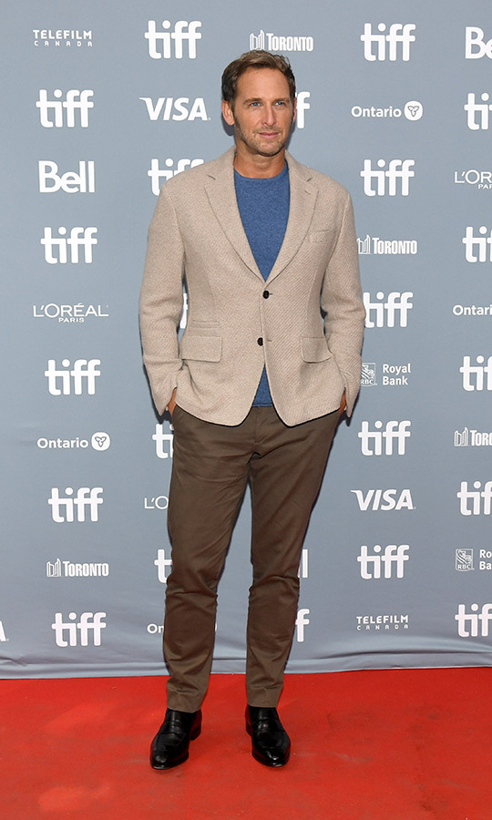 "<strong><a href=""/tags/0/josh-lucas"">Josh Lucas</a></strong> looked casual and dressy at once with a tan blazer, brown dress pants and a blue T-shirt at the <i>Ford v Ferrari</i> press conference.