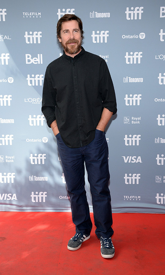 "<strong><a href=""/tags/0/christian-bale"">Christian Bale</a></strong> looked relaxed in a black dress shirt, jeans and Adidas shoes at the <i>Ford v Ferrari</i> press conference.