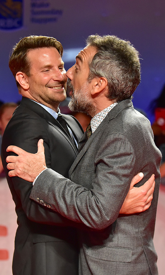 "<I>Joker</i> producer <strong><a href=""/tags/0/bradley-cooper"">Bradley Cooper</a></strong> and director <Strong>Todd Phillips</strong> had a pretty funny moment on the red carpet on Sept. 9!