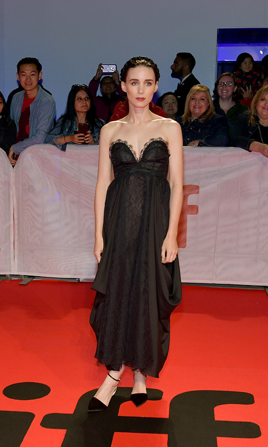 "<strong><a href=""/tags/0/rooney-mara"">Rooney Mara</a></strong>, <strong><a href=""/tags/0/joaquin-phoenix"">Joaquin Phoenix</a></strong>'s girlfriend, looked gorgeous in a black gown on the <i>Joker</i> red carpet.