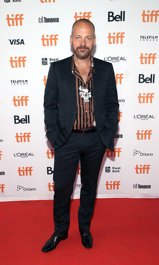 "<strong><a href=""/tags/0/peter-sarsgaard"">Peter Sarsgaard</a></strong> brought some striped flair to his outfit on the <i>Human Capital</i> red carpet!