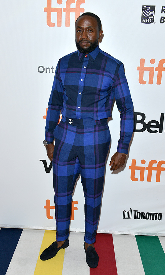 <strong>Byron Bowers</strong> had a very unique look on the <i>Honey Boy</i> red carpet with this blue plaid suit! 