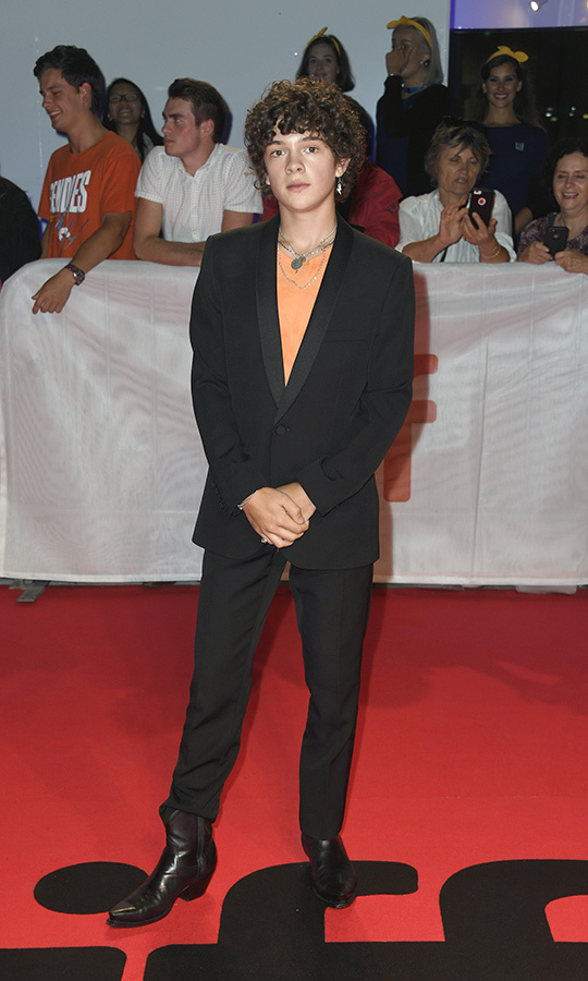 "<strong><a href=""/tags/0/noah-jupe"">Noah Jupe</a></strong>, who's already made waves with his unique style on the <i>Ford v Ferrari</i> red carpet this week, looked great in slick black boots, a black suit, orange shirt and unique jewellery. He had his <i>Harry Potter</i> earring on display again, too!