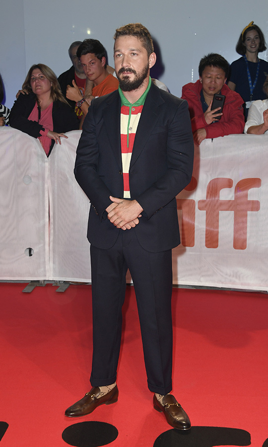 "When's the last time you saw a red, white and green polo shirt under a suit? <strong><a href=""/tags/0/shia-labeouf"">Shia LaBeouf</a></strong> did just that on the <i>Honey Boy</i> red carpet on Sept. 10.