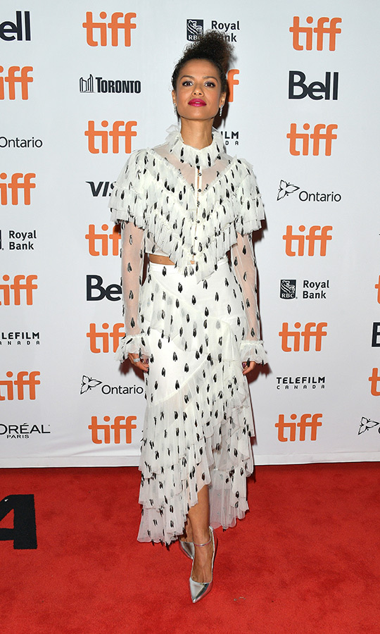 "<strong><a href=""/tags/0/gugu-mbatha-raw"">Gugu Mbatha-Raw</a></strong> looked like a total queen in her dress, which is by <strong><a href=""/tags/0/rodarte"">Rodarte</a></strong>, on the <i>Guest of Honour</i> red carpet.