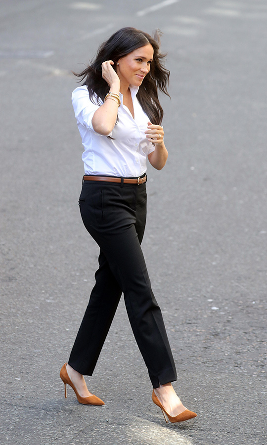 "Meghan arrived at the event wearing a shirt designed by her friend <strong><a href=""/tags/0/misha-nonoo"">Misha Nonoo</a></strong>, pants by <strong><a href=""/tags/0/jigsaw"">Jigsaw</a></strong> (both part of The Smart Set collection), a tan <strong><a href=""/tags/0/ralph-lauren"">Ralph Lauren</a></strong> belt and <strong><a href=""/tags/0/jimmy-choo"">Jimmy Choo</a></strong> shoes. Meghan was also wearing a gold cuff bracelet once owned by <Strong><a href=""/tags/0/princess-diana"">Princess Diana</a></strong>, along with Diana's butterfly earrings. Meghan wore both pieces of jewellery while on tour in Australia, New Zealand, Tonga and Fiji last year.