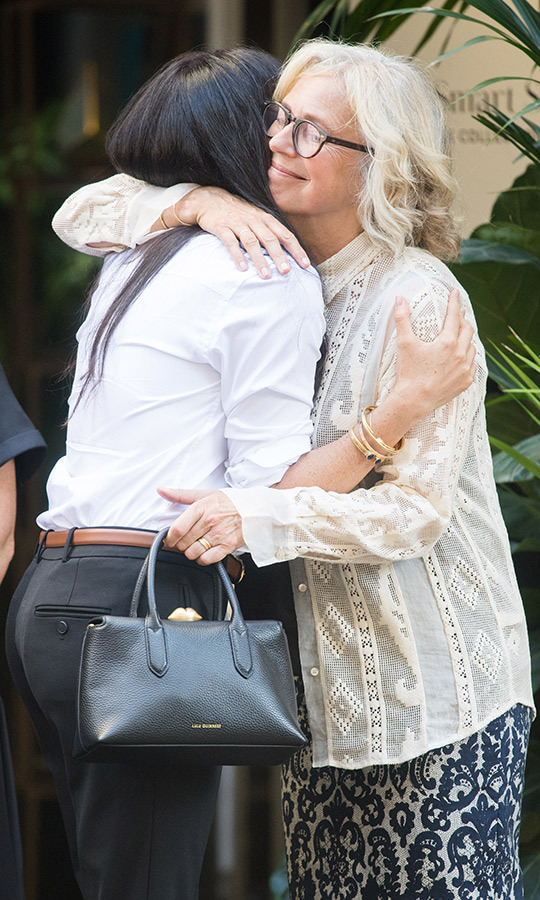 Meghan gave several people who had helped her work on the capsule collection huge hugs when she arrived.