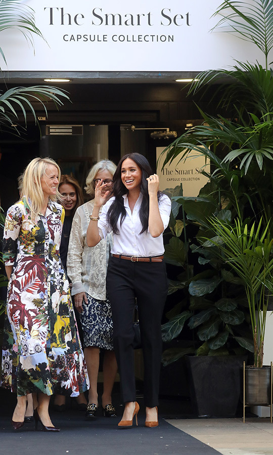 The capsule collection has its own branding, and Meghan looked so thrilled to have been part of the initiative when she left the event.