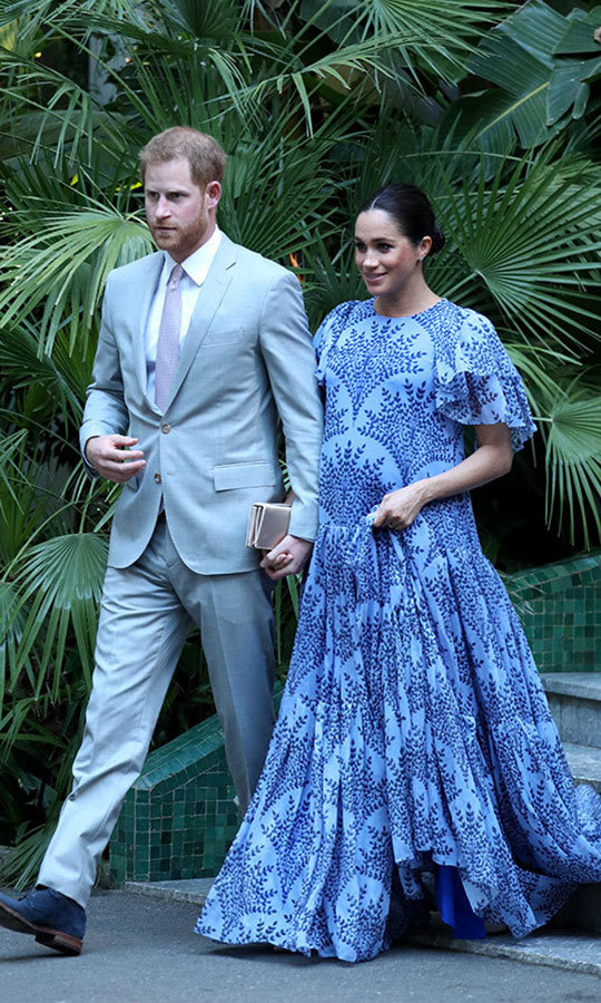 "On their final evening in Morocco on Feb. 25, <strong><A href=""/tags/0/meghan-markle"">Meghan Markle</a></strong> chose a stunning <strong><a href=""/tags/0/carolina-herrera"">Carolina Herrera</a></strong> dress for a reception with <strong>King Mohammed VI</strong>. She and Harry arrived hand-in-hand, looking completely in love.