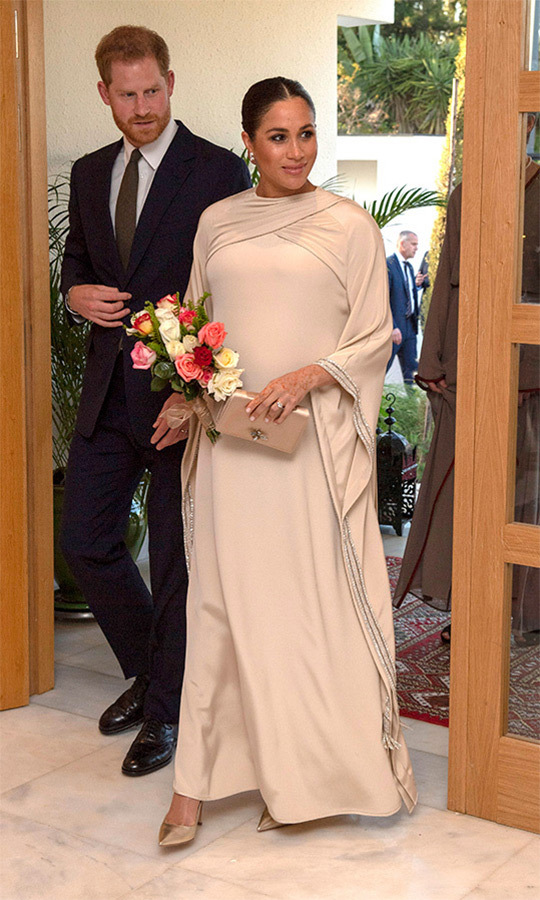 "On Feb. 24, the couple attended a reception hosted by the British Ambassador to Morocco at the British Residence in Rabat. Meghan looked absolutely stunning in a custom <strong><a href=""/tags/0/dior"">Dior</a></strong> caftan with jewels on its sleeves. 