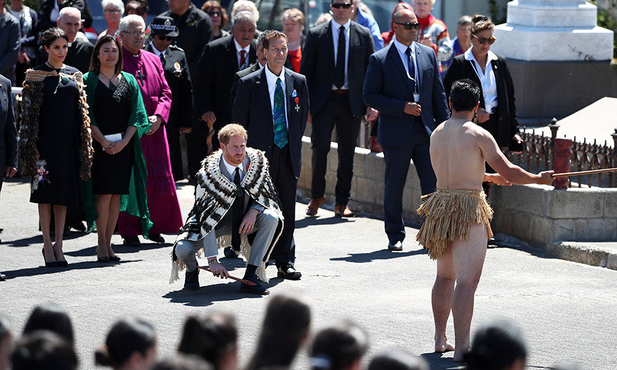 "Also earlier in the day, <Strong><a href=""/tags/0/meghan-markle"">Meghan</a></strong> and <strong><a href=""/tags/0/prince-harry"">Harry</a></strong> took part in a  powhiri, a traditional Māori welcoming ceremony, while arriving in Rotorua. The couple both wore Korowai, Māori cloaks, for the event, and Harry even participated in the Wero part of the ceremony (pictured), which involves warriors determining if their visitors' intents are peaceful or hostile. 