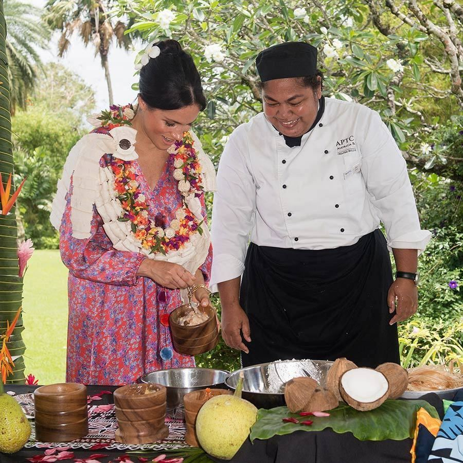 "While at a lunch at the British High Commissioner's residence, <strong><a href=""/tags/0/meghan-markle"">Meghan</a></strong> learned how to make a dish called lote, which is made using smoked breadfruit. 