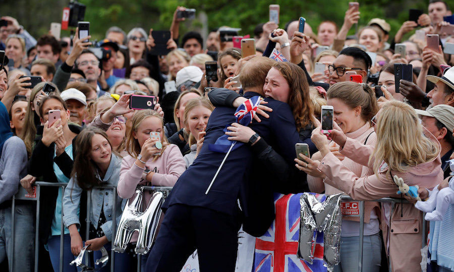 "So sweet! <strong><a href=""/tags/0/prince-harry"">Harry</a></strong> gave this fan, who was overwhelmed at seeing him and <strong><a href=""/tags/0/meghan-markle"">Meghan</a></strong>, a huge hug when they arrived in Melbourne on Oct. 18.