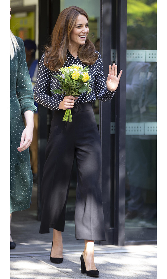 "Surprise! <strong><a href=""/tags/0/kate-middleton"">Duchess Kate</a></strong> stepped out for an engagement at the Sunshine House Children and Young People's Health and Development Centre on Sept. 19! The mom of three looked gorgeous in a polka-dot blouse and black wide-leg trousers and black <strong><a href=""/tags/0/gianvito-rossi"">Gianvito Rossi</a></strong> pumps.