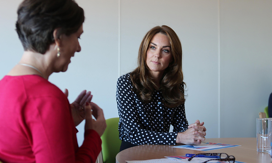 Kate listened intently as a staff member spoke to her about the program's important work. 