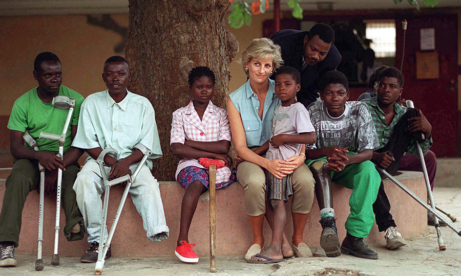 "At left, <strong><a href=""/tags/0/princess-diana"">Princess Diana</a></strong> is seen with some of those (including children) affected by landmines throughout the country at a clinic in Luanda, the Angolan capital. 
