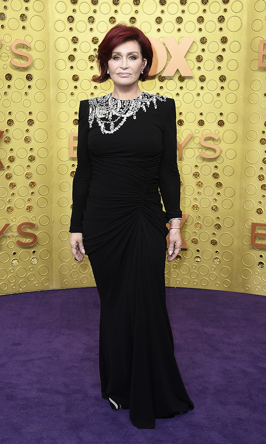 "Kelly's mom <strong><a href=""/tags/0/sharon-osbourne"">Sharon Osbourne</a></strong> looked fantastic in a black gown with a silver neckline.
