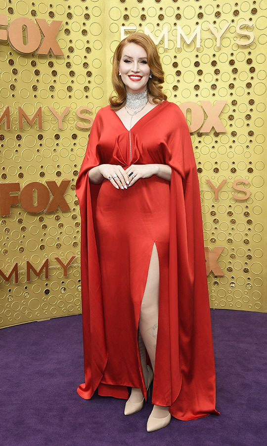 "Trans writer <strong><A href=""/tags/0/our-lady-j"">Our Lady J</a></strong>, nominated for her work on <i>Pose</i>, stunned in a gorgeous gaped red gown with beige heels.