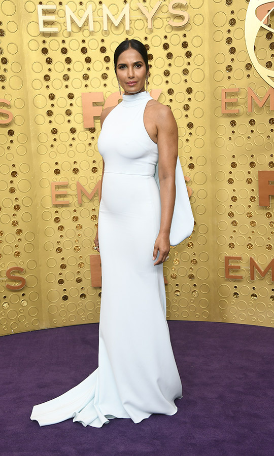 "<strong><a href=""/tags/0/padma-lakshmi"">Padma Lakshmi</a></strong> looked so gorgeous on the Emmys red carpet! She chose a stunning azure dress with a mini cape and wore her hair parted and tied back. 