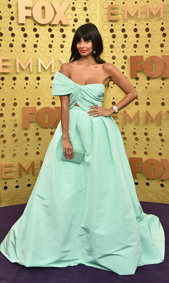 "<strong><a href=""/tags/0/jameela-jamil"">Jameela Jamil</a></strong> had a case of gastritis before hitting the Emmys red carpet and was reportedly quite physically sick just hours prior to the show! But she looked great on the red carpet in a one-shoulder azure gown with a bow as its bodice. She carried a matching clutch.