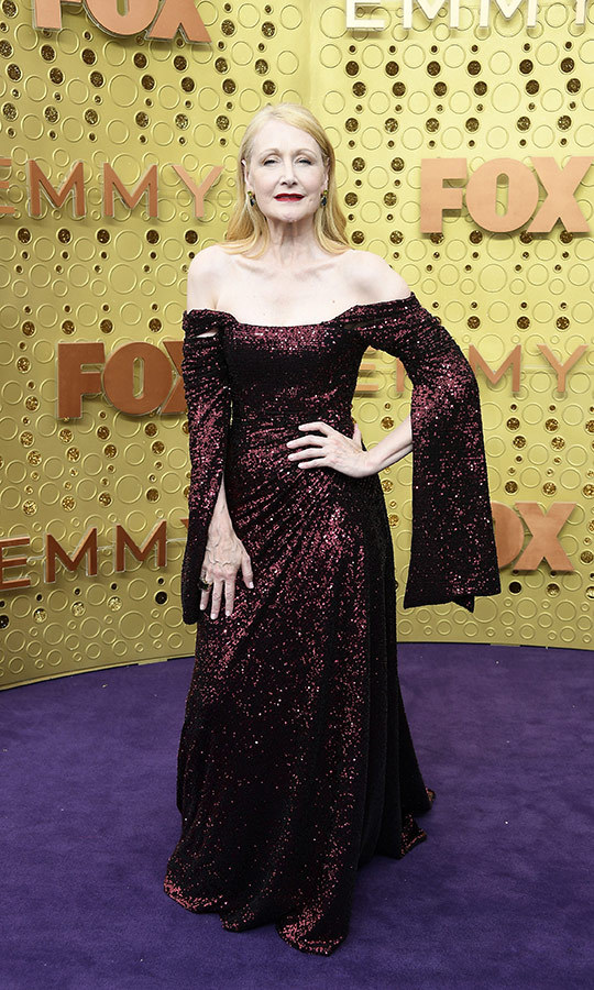 "<strong><a href=""/tags/0/patricia-clarkson"">Patricia Clarkson</a></strong> chose a glittery, sequined burgundy gown that featured long, slit sleeves.
