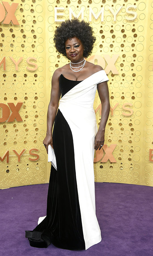 "<strong><a href=""/tags/0/viola-davis"">Viola Davis</a></strong> chose a very similar look to Catherine O'Hara, except her gown had more angular patterns!