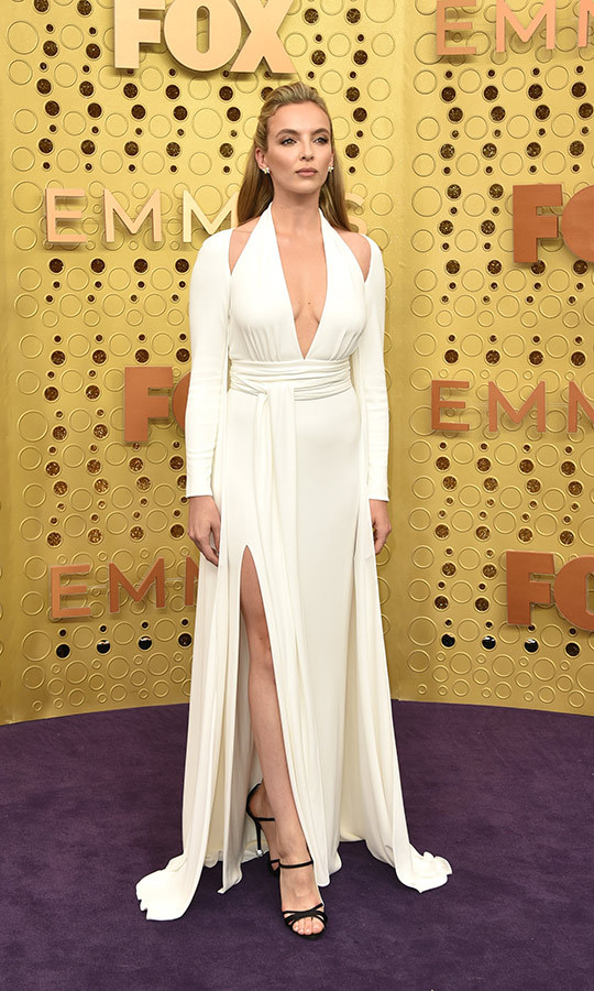 "<strong><a href=""/tags/0/jodie-comer"">Jodie Comer</a></strong>'s Emmys look was incredible! The <i><strong><a href=""/tags/0/killing-eve"">Killing Eve</a></i></strong> star looked amazing in a Tom Ford white halter-neck evening gown with Roger Vivier heels.