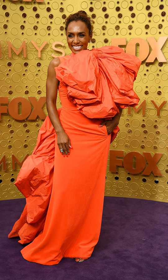 "<strong><a href=""/tags/0/janet-mock"">Janet Mock</a></strong> looked gorgeous as always in a bright orange gown with a massive ruffle on its bodice. 