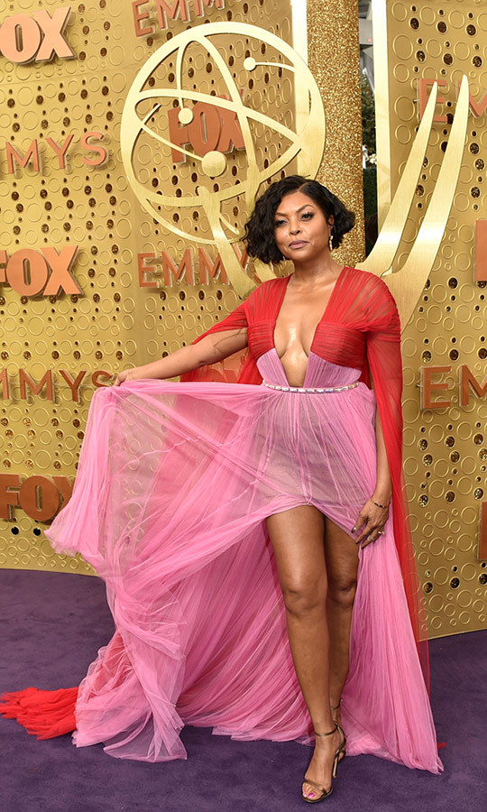 "<strong><a href=""/tags/0/taraji-p-henson"">Taraji P. Henson</a></strong> killed it on the Emmys red carpet! She wore a gorgeous red-and-pink Vera Wang dress with a plunging neckline and pleated sleeves and looked on fire.