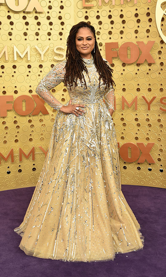 Director <strong>Ava DuVernay</strong> stunned in a gold dress with silver accents.