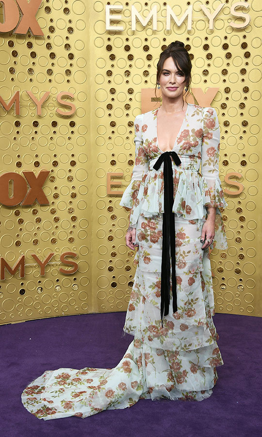 "<strong><a href=""/tags/0/lena-headey"">Lena Headey</a></strong> chose a tiered floral dress with a black bow. 
