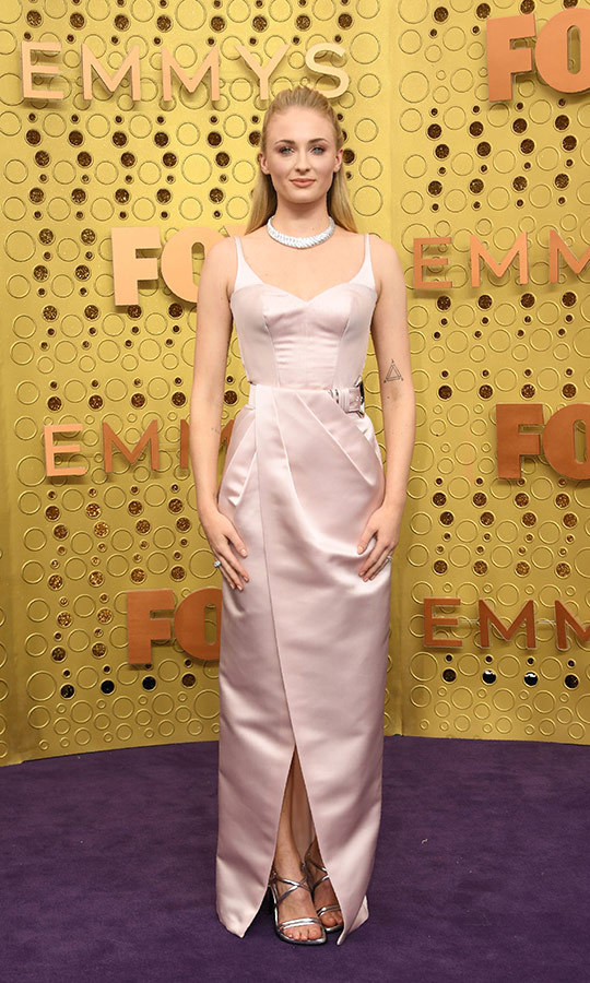 "<strong><a href=""/tags/0/sophie-turner"">Sophie Turner</a></strong> wore a blush Louis Vuitton gown with a belted waist and looked lovely. She wore a diamond collared necklace and silver stilettos.