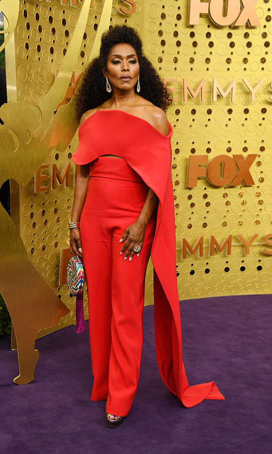 "<strong><a href=""/tags/0/angela-bassett"">Angela Bassett</a></strong> wore a bright red jumpsuit with caped shoulders, which she complimented with a handbag that looked like a lollipop.