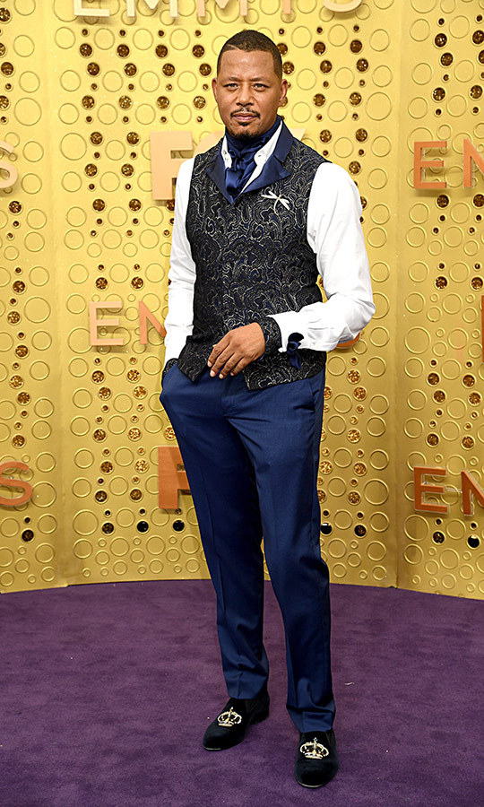 "<strong><a href=""/tags/0/terrence-howard"">Terrence Howard</a></strong> was wearing all sorts of patterns and textures on the Emmys red carpet! Those shoes are certainly regal!