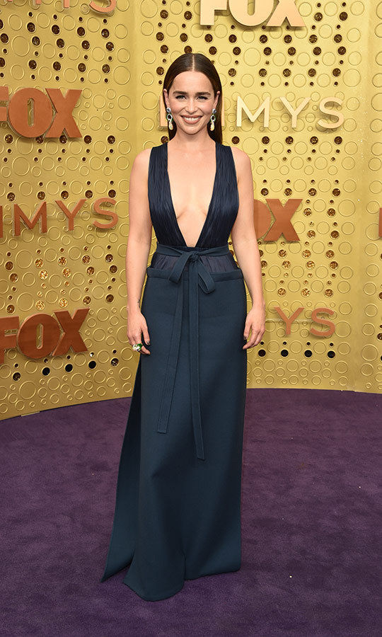 "<strong><a href=""/tags/0/emilia-clarke"">Emilia Clarke</a></strong> looked beautiful in a navy dress with a plunging neckline.