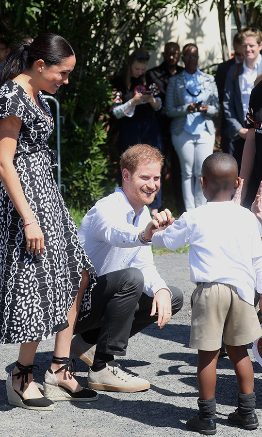 Harry got along really well with this adorable little boy, who he asked for a high five. He happily and adorably obliged. Meghan was incredibly touched by how much they liked each other! 